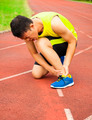 young male runner with ankle injury on track - PhotoDune Item for Sale