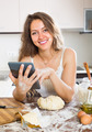Housewife cooking with tablet at home - PhotoDune Item for Sale