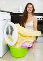 Pretty woman washing clothes in washer - PhotoDune Item for Sale