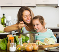 Happy mother with daughter cooking together - PhotoDune Item for Sale