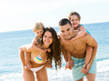 Family with two kids on beach - PhotoDune Item for Sale