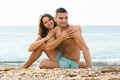 smiling guy and his girlfriend  on sand beach - PhotoDune Item for Sale