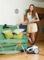 Woman vacuuming living room - PhotoDune Item for Sale