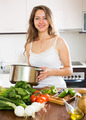 long-haired  woman cooking  soup - PhotoDune Item for Sale