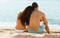 Loving pair relaxing on sand beach - PhotoDune Item for Sale