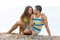 Happy couple having romantic date on sandy beach - PhotoDune Item for Sale