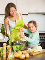 Woman with little girl cooking at home - PhotoDune Item for Sale