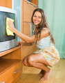 Brunette cleaning glass of furniture - PhotoDune Item for Sale