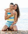 loving couple having romantic date on sandy beach - PhotoDune Item for Sale