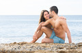 couple resting on the beach - PhotoDune Item for Sale