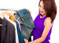 happy smiling asian woman choosing shopping clothes over white background - PhotoDune Item for Sale