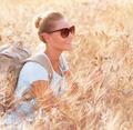 Happy traveler in wheat field - PhotoDune Item for Sale