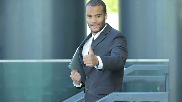 A Successful Businessman Showing Thumb Up
