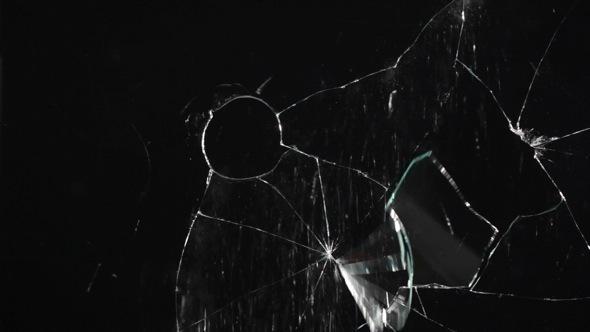 Glass Breaks from a Bullet