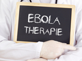Doctor shows information: Ebola therapy in german language - PhotoDune Item for Sale
