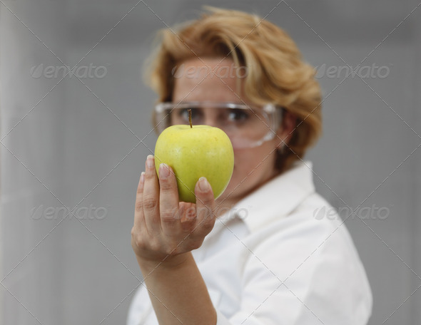 Researcher Offering an Apple  - Stock Photo - Images