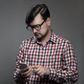 Handsome Hipster Modern Man Using Smartphone. - PhotoDune Item for Sale