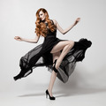 Fashion Woman In Fluttering Black Dress. White Background. - PhotoDune Item for Sale
