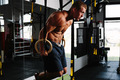 Muscular man working out on gymnastic rings - PhotoDune Item for Sale