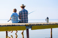 boy and his father fishing togethe - PhotoDune Item for Sale