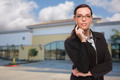 Attractive Serious Mixed Race Woman In Front of Vacant Commercial Retail Building. - PhotoDune Item for Sale