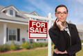 Attractive Mixed Race Woman in Front of House and For Sale Real Estate Sign. - PhotoDune Item for Sale