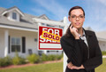 Attractive Mixed Race Woman in Front of House and Sold Real Estate Sign. - PhotoDune Item for Sale