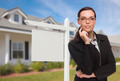 Mixed Race Woman In Front of House and Blank Real Estate Sign - PhotoDune Item for Sale