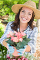 Attractive Happy Young Adult Woman Wearing Hat and Gloves Gardening Outdoors. - PhotoDune Item for Sale