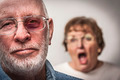 Battered and Scared Man with Screaming Angry Woman Behind. - PhotoDune Item for Sale