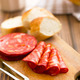sliced chorizo salami on cutting board - PhotoDune Item for Sale