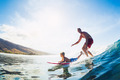 Father and Son Surfing, Riding Wave Together - PhotoDune Item for Sale