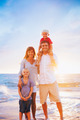 Portrait of Family on the Beach at Sunset - PhotoDune Item for Sale