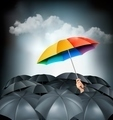 One rainbow umbrella standing out on a grey background. Unique concept - PhotoDune Item for Sale
