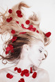 Woman with rose petals in her hair - PhotoDune Item for Sale