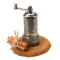 cinnamon and manual grinder isolated on white background - PhotoDune Item for Sale