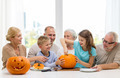 happy family sitting with pumpkins at home - PhotoDune Item for Sale