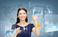 smiling businesswoman working with virtual screen - PhotoDune Item for Sale
