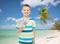 smiling boy holding dollar cash money in his hand - PhotoDune Item for Sale