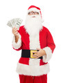 man in costume of santa claus with dollar money - PhotoDune Item for Sale