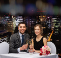 couple with glasses of champagne at restaurant - PhotoDune Item for Sale