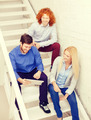 team with tablet pc computer sitting on staircase - PhotoDune Item for Sale
