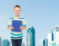 smiling little student boy with blue book - PhotoDune Item for Sale