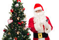 santa claus with smartphone and christmas tree - PhotoDune Item for Sale
