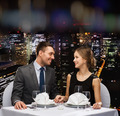 smiling couple looking at each other at restaurant - PhotoDune Item for Sale