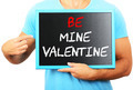 Man holding blackboard in hands and pointing the word BE MINE VA - PhotoDune Item for Sale