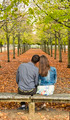 Young Couple Sitting on a Bench in a Park in Autumn - PhotoDune Item for Sale