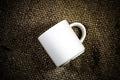 White coffee cup on a hemp sack. - PhotoDune Item for Sale
