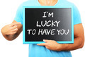 Man holding blackboard in hands and pointing the word I AM LUCKY - PhotoDune Item for Sale