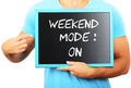 Man holding blackboard in hands and pointing the word WEEKEND MO - PhotoDune Item for Sale
